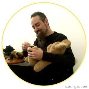 Juan Lebron carrying out a sheepskin teddy repair